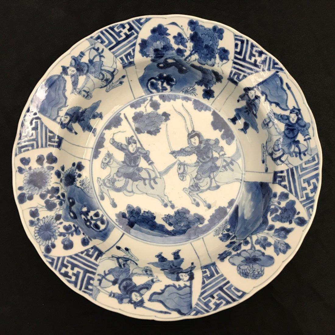 Blauw/witte porseleinen kom van twee jagers te paard, China, Kangxi periode