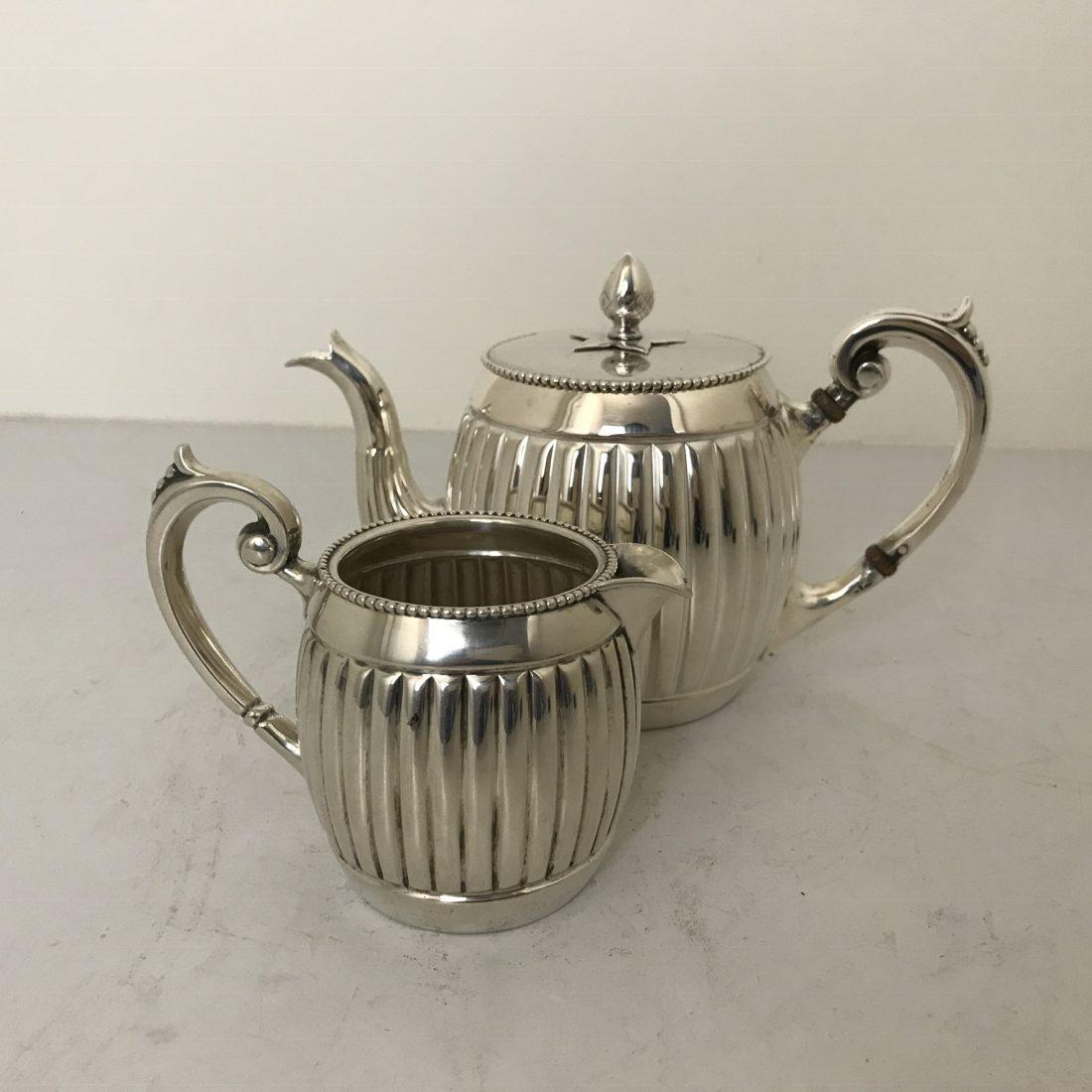 Een twee delig Zilveren koffie servies, van Kempen & Begeer te Voorschoten, 1902