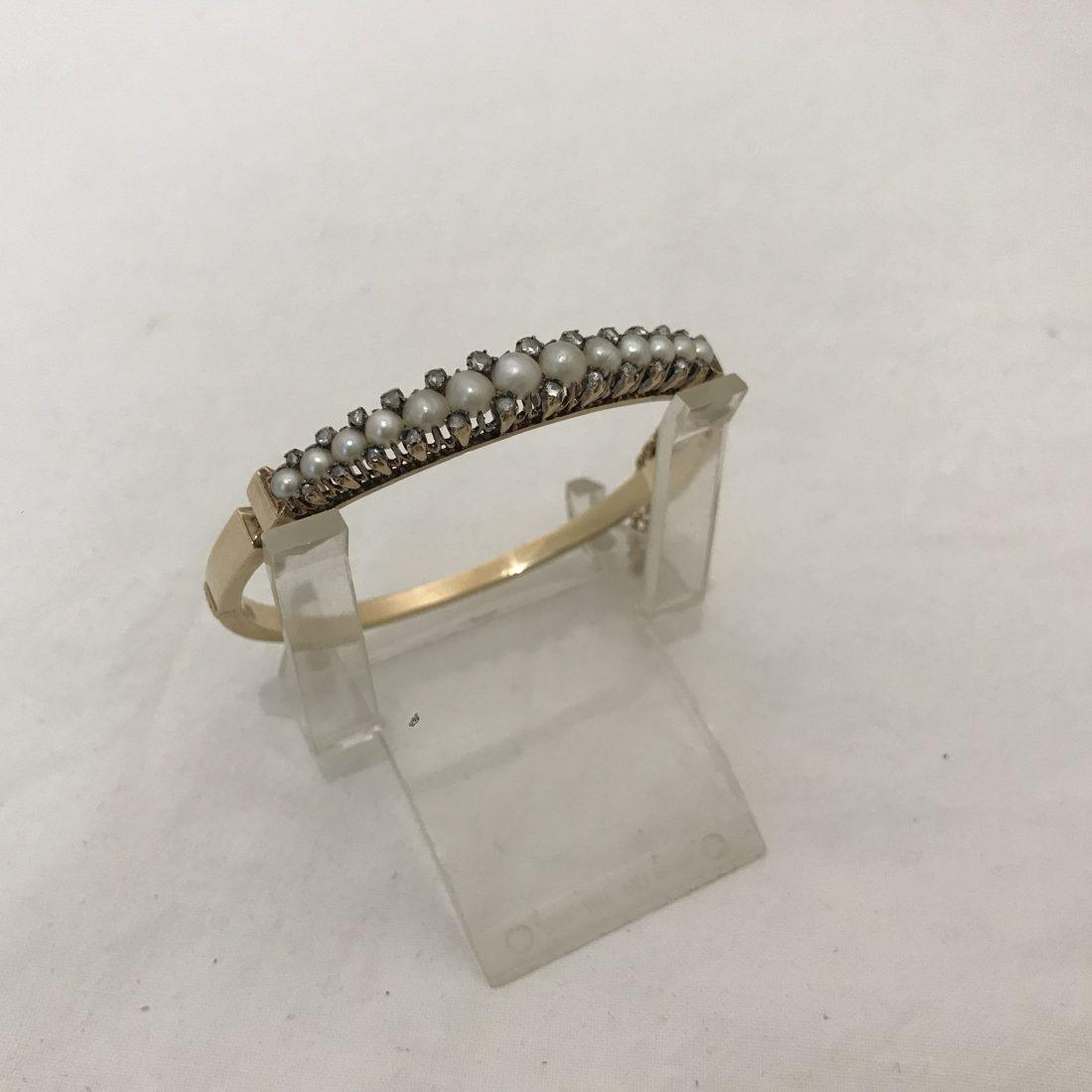 Een 14 karaat Gouden armband met zaadparels,  Antiek